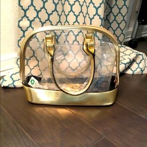 New Gold and clear purse